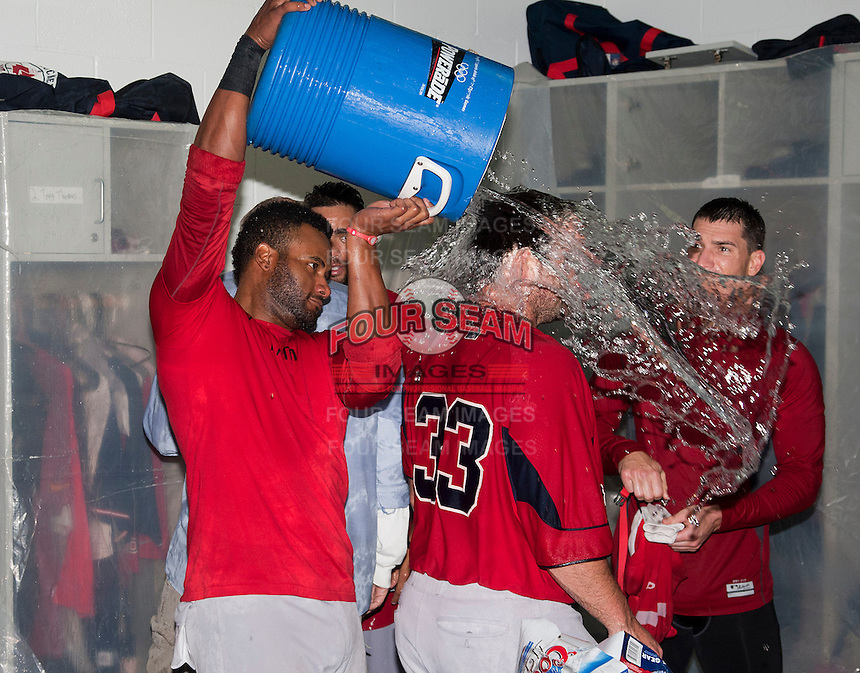 Pawtucket Red Sox infielder Tony Thomas #2 dumps water over teammate Dan Butler #33 head as the team celebrates in the locker room after game four of a best of five playoff series against the Empire State Yankees at Frontier Field on September 8, 2012 in Rochester, New York.  Pawtucket defeated Empire State 7-1 to advance to the International League Finals.  (Mike Janes/Four Seam Images)