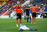 St Johnstone v Dundee United...27.08.11   SPL Week 5.Johnny Russell pleads his innocence after kicking David Robertson in the face for a penalty.Picture by Graeme Hart..Copyright Perthshire Picture Agency.Tel: 01738 623350  Mobile: 07990 594431