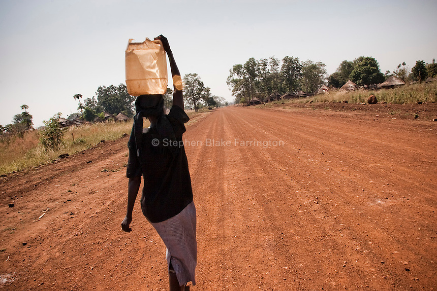 Woamn takes water to her home. Pageri, Sudan