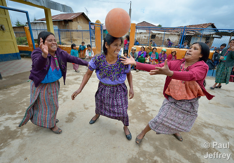 Maria Valentina Lopez appears to be heading the ball as indigenous women play basketball in Tuixcajchis, a small Mam-speaking Maya village in Comitancillo, Guatemala.