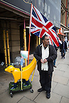 """© Joel Goodman - 07973 332324 . 28/03/2015 . Manchester , UK . A man protesting against the neo-Nazis brought his yellow banana dog and """" Yellow Pride """" Union flag . Approximately 100 neo-Nazis gather in Manchester for """" White Pride Worldwide day """" . Photo credit : Joel Goodman"""