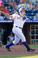 Stephen Vogt #30 of the Durham Bulls follows through on his swing against the Charlotte Knights at Durham Bulls Athletic Park on August 28, 2011 in Durham, North Carolina.   (Brian Westerholt / Four Seam Images)