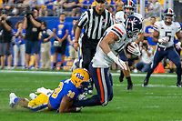 Pitt linebacker Cam Bright tackles Virginia tight end Tanner Cowley. The Virginia Cavaliers defeated the Pitt Panthers 30-14 in a football game at Heinz Field, Pittsburgh, Pennsylvania on August 31, 2019.
