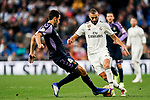 Karim Benzema of Real Madrid (R) competes for the ball with Francisco Jose Olivas Alba, K Olivas, of Real Valladolid during the La Liga 2018-19 match between Real Madrid and Real Valladolid at Estadio Santiago Bernabeu on November 03 2018 in Madrid, Spain. Photo by Diego Souto / Power Sport Images