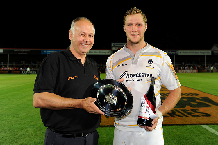 20130801 Copyright onEdition 2013 ©<br /> Free for editorial use image, please credit: onEdition.<br /> <br /> Philip Thitchener (South West Regional Director, J.P. Morgan Asset Management) presents the plate to Richard de Carpentier of Worcester Warriors 7s after winning Pool A of the J.P. Morgan Asset Management Premiership Rugby 7s Series.<br /> <br /> The J.P. Morgan Asset Management Premiership Rugby 7s Series kicks off for the fourth season on Thursday 1st August with Pool A at Kingsholm, Gloucester with Pool B being played at Franklin's Gardens, Northampton on Friday 2nd August, Pool C at Allianz Park, Saracens home ground, on Saturday 3rd August and the Final being played at The Recreation Ground, Bath on Friday 9th August. The innovative tournament, which involves all 12 Premiership Rugby clubs, offers a fantastic platform for some of the country's finest young athletes to be exposed to the excitement, pressures and skills required to compete at an elite level.<br /> <br /> The 12 Premiership Rugby clubs are divided into three groups for the tournament, with the winner and runner up of each regional event going through to the Final. There are six games each evening, with each match consisting of two 7 minute halves with a 2 minute break at half time.<br /> <br /> For additional images please go to: http://www.w-w-i.com/jp_morgan_premiership_sevens/<br /> <br /> For press contacts contact: Beth Begg at brandRapport on D: +44 (0)20 7932 5813 M: +44 (0)7900 88231 E: BBegg@brand-rapport.com<br /> <br /> If you require a higher resolution image or you have any other onEdition photographic enquiries, please contact onEdition on 0845 900 2 900 or email info@onEdition.com<br /> This image is copyright the onEdition 2013©.<br /> <br /> This image has been supplied by onEdition and must be credited onEdition. The author is asserting his full Moral rights in relation to the publication of this image. Rights for onward transmission of any image or file is not granted o