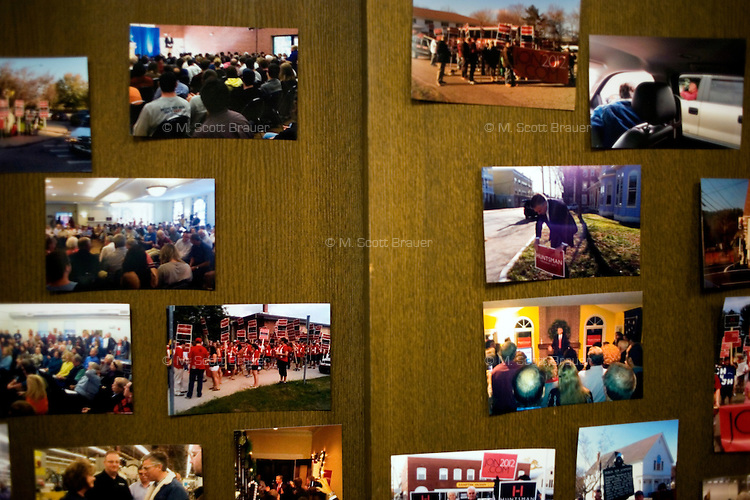 Photos from campaign events hang on a wall at the Jon Huntsman New Hampshire campaign headquarters in Manchester, New Hampshire, on Jan. 7, 2012.  Huntsman is seeking the 2012 Republican presidential nomination.