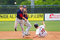 Blake Kelso #5 of the Hagerstown Suns turns a double play as Jace Whitmer #39 of the Rome Braves slides into second base at State Mutual Stadium on May 1, 2011 in Rome, Georgia.   Photo by Brian Westerholt / Four Seam Images