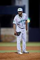 Daytona Tortugas relief pitcher Juan Martinez (18) looks in for the sign during a game against the Tampa Tarpons on April 18, 2018 at George M. Steinbrenner Field in Tampa, Florida.  Tampa defeated Daytona 12-0.  (Mike Janes/Four Seam Images)