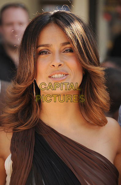Salma Hayek.The L.A. Premiere of 'Puss in Boots' held at The Regency Village Theatre in Westwood, California, USA..October 23rd, 2011.headshot portrait black brown sheer one shoulder .CAP/ROT/TM.©Tony Michaels/Roth Stock/Capital Pictures
