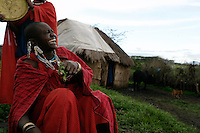 Photographs are from the family of Ole Surupe(old man wrapped in blanket).  He was the main chief when the Maasai were kicked out of Serengeti National Park.  Then they were kicked out of the crater which is now Tanzania's main tourist attraction. Now they feel like they are squatters on their land and might be kicked out of the NCA at any time. This family cannot cultivate much, can't buy a tractor, can't fence their land etc... etc... because they are in a multi-use area of the NCA.  So this family survives mostly on milk.  In 2001 the prime minister declared it illegal to cultivate in the NCA, but that didn't work.  But it is still illegal to use a tractor or hire someone to help in the garden or to use a plow.  The government is a kleptocracy as well as being afraid of putting in infrastructure that would lead to permanent settlements that would stop the migration..The NCA is a multi-use area and there are many people looking after conservation, but very few involved with social services.  The Maasai are caught in the middle.  Rules are incredibly strict in terms of cultivation, firewood and other basics of a pastoral existence.  There are six main communities in the NCA and only two have wells.  The Maasai in this area generally share their water supply with their animals and survive mostly on milk and porridge. ..The migration is like the wild west before they killed all the buffalo.  1.5 million wildebeest are like a train with 200 cars and each car dumps 20 tons of dung a day.  Fertilizer for the entire ecosystem.  Just the saliva from their mouths is enough to keep the grass hydrated...Contact info:.Peter Jones  347 968 6978 USA Mobile.255 744 293 387 TZ Mobile.His email: jones@habari.co.tz  or Ndarakwai@aol.com.http://www.tanzania-safari.com.www.ndarakwai.com.Phone: (255) 27 2502713 .Fax: (255) 27 2508547 .eFax Number: (1) 646 349 3793 .Mobile Phone: +255 744 333550 .Mail:.Tanganyika Film & Safari Outfitters .P.O. Box 49, Arusha, Tanzania, East Africa.Main