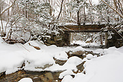 Old bridge, which crosses Lafayette Brook, along the Notchway Trail covered in snow. The Notchway Trail is the main trail of the Lafayette Ski Trails and follows the old Route 3 between Route 141 and Route 18 in the town of Franconia, New Hampshire.
