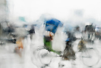 BANGLADESH, blurred bicycle rickshaw seen through wet window