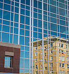 windows of first interstate bank building reflect the wilma building in downtown missoula, montana