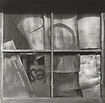 Scan of vintage print. 1970's. Old shed window with cardboard.