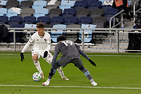 ST PAUL, MN - OCTOBER 28: Cole Bassett #26 of Colorado Rapids passes the ball past Romain Metanire #19 of Minnesota United FC during a game between Colorado Rapids and Minnesota United FC at Allianz Field on October 28, 2020 in St Paul, Minnesota.