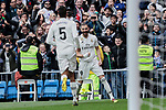 Real Madrid's Raphael Varane (L) and Karim Benzema (R) celebrate goal during La Liga match between Real Madrid and Athletic Club de Bilbao at Santiago Bernabeu Stadium in Madrid, Spain. April 21, 2019. (ALTERPHOTOS/A. Perez Meca)