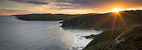 Southern views of Pacific Ocean along coastline from Nugget Point at sunset, Catlins, Southland, New Zealand, NZ
