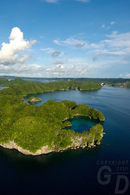 Aerial of the Rock Islands,Palau, Micronesia with Pinchers lagoon in the foreground the town of Koror is in the background