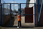 A young away fan waiting for the turnstiles to open outside Palmerston Park, Dumfries before Queen of the South hosted Dundee United in a Scottish Championship fixture. The home has played at the same ground since its formation in 1919. Queens won the match 3-0 watched by a crowd of 1,531 spectators.