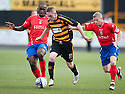 Alloa's Declan McManus tries to get away from Cowdenbeath's Nathaniel Wedderburn and Marc McKenzie.
