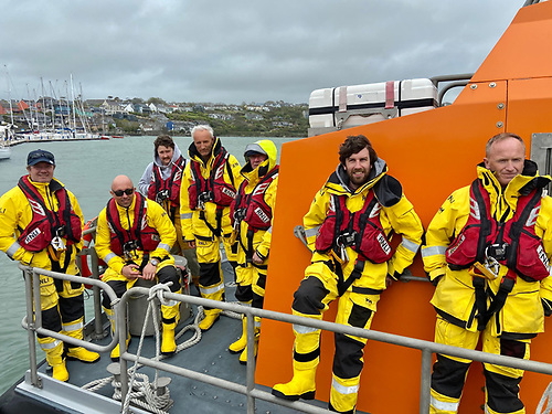 The seven Courtmacsherry RNLI Lifeboat crew members under Coxswain Mark Gannon after they arrived into Kinsale Harbour with the fishing vessel