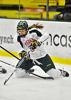 29 January 2012: University of Vermont Catamount forward Erin Wente, a Junior from Scottsdale, AZ, in action against the University of New Hampshire Wildcats at Gutterson Fieldhouse in Burlington, Vermont. The Lady Cats, dressed in their Breast Cancer Awareness jerseys, edged out the Wildcats 2-1 to split their Hockey East twin-game weekend series. Mandatory Credit: Ed Wolfstein Photo
