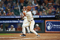 Eric Kennedy (30) of the Texas Longhorns follows through on his swing against the Arkansas Razorbacks in game six of the 2020 Shriners Hospitals for Children College Classic at Minute Maid Park on February 28, 2020 in Houston, Texas. The Longhorns defeated the Razorbacks 8-7. (Brian Westerholt/Four Seam Images)