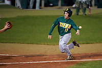 Siena Saints third baseman Jordan Folgers (12) slides into home during a game against the Stetson Hatters on February 23, 2016 at Melching Field at Conrad Park in DeLand, Florida.  Stetson defeated Siena 5-3.  (Mike Janes/Four Seam Images)