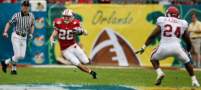 Defensive back Zach Hampton returns an Arkansas kickoff during the run up to the Badger's 17-14 victory.<br />