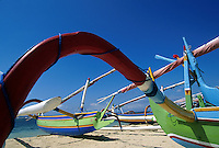 Colorful hand painted outrigger canoes on Sanur Beach Bali Indonesia.