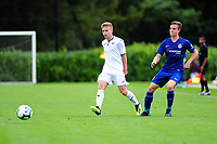 Marc Walsh of Swansea City battles with James Clark of Chelsea FC during the Premier League u18 match between Swansea City AFC and Chelsea FC at Landore Training Ground, Wales, UK. Tuesday 11th September 2018