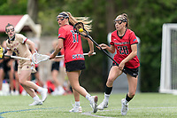 NEWTON, MA - MAY 14: Maggie Reynolds #28 of Fairfield University clears the ball during NCAA Division I Women's Lacrosse Tournament first round game between Fairfield University and Boston College at Newton Campus Lacrosse Field on May 14, 2021 in Newton, Massachusetts.