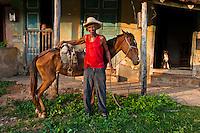 Juan Bastida, on his 83rd birthday,  with his horse and smoking a cigar.
