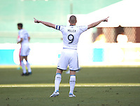 Kenny Miller (9) of the Vancouver Whitecaps tries to tell his goalkeeper to punt the ball away from him during a Major League Soccer match at RFK Stadium in Washington, DC. D.C. United lost to the Vancouver Whitecaps, 1-0.