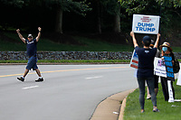 A Trump supporter reacts to protesters gather outside Trump National Golf Club Washington DC in Sterling, Virginia while United States President Donald J. Trump plays golf on June 21, 2020. <br /> Credit: Yuri Gripas / Pool via CNP/AdMedia