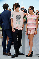 """CANNES, FRANCE - JULY 13: French-Us actor Timothee Chalamet and French-Algerian actress Lyna Khoudri, at photocall for the film """"The French Dispatch"""" at the 74th annual Cannes Film Festival in Cannes, France on July 13, 2021 <br /> CAP/GOL<br /> ©GOL/Capital Pictures"""