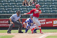 Memphis Redbirds shortstop Greg Garcia #5 follows through on his swing during the Pacific Coast League baseball game against the Round Rock Express on April 27, 2014 at the Dell Diamond in Round Rock, Texas. The Express defeated the Redbirds 6-2. (Andrew Woolley/Four Seam Images)