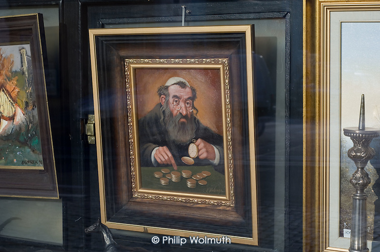 Caricature paintings of a Jew counting money for sale in a shop in Lublin.  One of a number of ventures set up by local non-Jewish Poles to exploit the city's Jewish history.