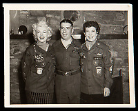 BNPS.co.uk (01202 558833)<br /> Pic: Julien'sAuctions/BNPS<br /> <br /> Marilyn Monroe wearing the jacket during her trip to Korea<br /> <br /> Marilyn Monroe's personalised army jacket and ID card have emerged for sale for £80,000. ($100,000)<br /> <br /> The starlet wore the green woollen jacket which is covered in army patches during her famous visit to entertain US troops in Korea in February 1954.<br /> <br /> The name 'Monroe' is in white stitching above the left pocket, and there are black and white photos of her posing in the long sleeved 'medium' sized jacket.<br /> <br /> Her 'Non Combatant's Certificate of Identity' card lists by her real name 'Norma Jeane DiMaggio' and there is a small photo of her in the top right hand corner of the laminated card, as well as her finger print.<br /> <br /> Monroe has signed it and a wealth of personal information is listed, including her date of birth, height, weight, hair colour and blood type. The items are being sold with Los Angeles based Julien's Auctions.