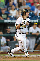 Vanderbilt Commodores outfielder Bryan Reynolds (20) follows through on his swing against the TCU Horned Frogs in Game 12 of the NCAA College World Series on June 19, 2015 at TD Ameritrade Park in Omaha, Nebraska. The Commodores defeated TCU 7-1. (Andrew Woolley/Four Seam Images)