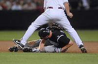 Apr 13, 2007; Phoenix, AZ, USA; Colorado Rockies right fielder (11) Brad Hawpe is tagged out in a run down by Arizona Diamondbacks shortstop (6) Stephen Drew in the sixth inning at Chase Field in Phoenix, AZ. Mandatory Credit: Mark J. Rebilas