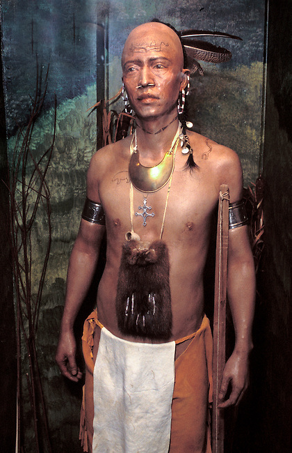 Traditional clothing of a Lenni-Lenape man with a buckskin breechcloth over leggings, animal skin bag and tatoos. He also wears adornment of wampum beads and trade silver. Allenstown Pennsylvania