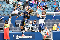 KANSAS CITY, KS - MAY 16: Gianluca Busio #10 Sporting KC beats Deiber Caicedo #7 Vancouver Whitecaps to the header during a game between Vancouver Whitecaps and Sporting Kansas City at Children's Mercy Park on May 16, 2021 in Kansas City, Kansas.