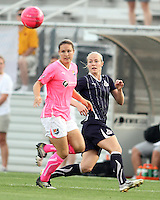 Becky Sauerbrunn #22 of the Washington Freedom sends the ball over Meghan Schnur #7 of Sky Blue FC during a WPS match at Yurcak Field on the campus of Rutgers University in New Brunswick, New Jersey on August 11 2010. The game ended in a 1-1 tie.
