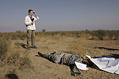 Kabul, Afghanistan<br /> November 21, 2001<br /> <br /> A Swedish TV reporter does a stand up over the corpse of a foreign Taliban fighter. The soldier was killed just days earlier when the Northern Alliance advance down this road from the Bagram Airport towards Kabul.