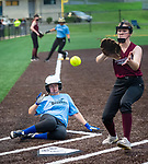 WATERBURY, CT 071321JS08  WCA's Chloe Cogovan (26) comes in to score on a passed ball as Naugatuck's Steph Sutherland (7) comes in to cover the play during their Joan Joyce softball league game Tuesday at Municipal Stadium in Waterbury. <br />  Jim Shannon Republican American