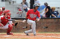 Third baseman Jonatan Hinojosa (7) of the Elizabethton Twins bats in a game against the Johnson City Cardinals on Sunday, July 27, 2014, at Howard Johnson Field at Cardinal Park in Johnson City, Tennessee. The game was suspended due to weather in the fifth inning. (Tom Priddy/Four Seam Images)