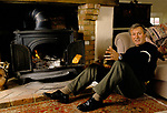 Julian Pettifer, British journalist, TV documentary presenter & reporter at home, his riverside cottage in the Home Counties 1980s