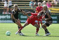 Leslie Osborne (left) and Lindsay Massengale (right) combine against Lisa DeVanna (center) FC Gold Pride defeated Washington Freedom 3-2 at Buck Shaw Stadium in Santa Clara, California on August 1, 2009.