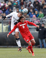 University of Connecticut defender Michael Mercado (3) and University of New Mexico forward Devon Sandoval (9) battle for head ball. .NCAA Tournament. With a goal in the second overtime, University of Connecticut (white) defeated University of New Mexico (red), 2-1, at Morrone Stadium at University of Connecticut on November 25, 2012.